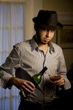 Young Man in a Fedora with Red Wine Royalty Free Stock Images