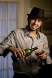 Young Man in a Fedora with Red Wine Stock Photography