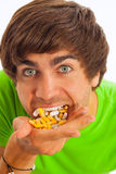Young man feeding himself pills Royalty Free Stock Photography