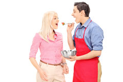 Young man feeding his wife Stock Photo