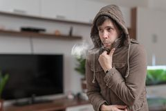 Young man feel cold at home.  stock photography