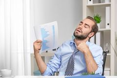 Young man feeling hot. In office Stock Photo