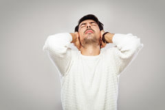 Young man feeling pain. Young man with closed eyes feeling pain Royalty Free Stock Photo