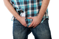 Young man feeling pain in his crotch. Royalty Free Stock Photography