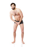 Young man feeling pain in his crotch. Stock Photos