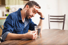 Young man feeling sick at home Stock Photo