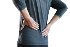Young man Feeling suffering  Lower back pain  Pain relief concep. T Royalty Free Stock Photos