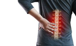 Young man Feeling suffering  Lower back pain  Pain relief concep. T Royalty Free Stock Photo