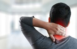 Young man Feeling suffering  Lower back pain  Pain relief concep. T Stock Photography