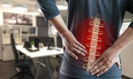 Young man Feeling suffering  Lower back pain  Pain relief concep. T Royalty Free Stock Image