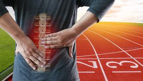 Young man Feeling suffering  Lower back pain  Pain relief concep Royalty Free Stock Images