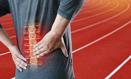 Young man Feeling suffering  Lower back pain  Pain relief concep Royalty Free Stock Photography