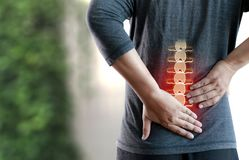 Young man Feeling suffering  Lower back pain  Pain relief concep. T Royalty Free Stock Images