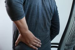 Young man Feeling suffering  Lower back pain  Pain relief concep. T Stock Photos