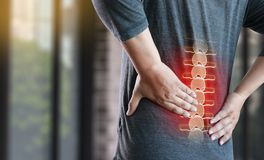 Young man Feeling suffering  Lower back pain  Pain relief concep. T Stock Photo