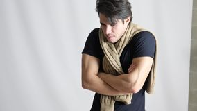 Young man feeling very cold, wearing scarf stock video