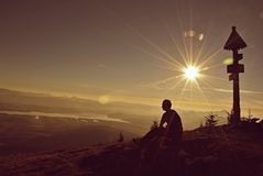 A young man feels free in the mountains at sunrise Royalty Free Stock Photos