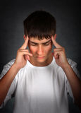 Young Man feels Headache Stock Photography