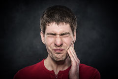 Young man feels toothache Royalty Free Stock Photography