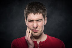 Young man feels toothache Stock Image