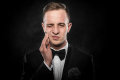 Young man feels toothache Stock Photo