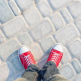 Young man feet in red sneakers Royalty Free Stock Image