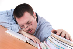 Young man fell asleep on books on table Royalty Free Stock Photos