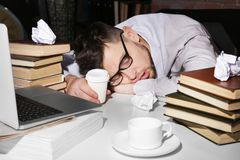 Young man fell asleep during reading. At workplace Royalty Free Stock Photography
