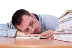 Young man fell asleep on tabel while reading book Stock Photography