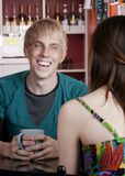 Young man with female friend Royalty Free Stock Image