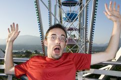 Young man on ferris wheel Stock Images