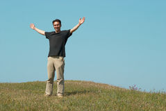 Young man on the field Stock Photography