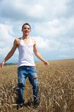 Young man in the field. Royalty Free Stock Images