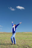 Young man in the field Royalty Free Stock Photos