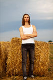 Young man in the field Royalty Free Stock Photo