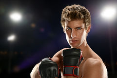Young Man with fighting gloves Stock Photo