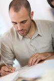Young man filling administrative forms Stock Photography
