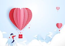 Young man finding love concept. Hot air balloons  flying. Young man finding love concept. Hot air balloons  flying over on mountains and cloud. paper art style Royalty Free Stock Images