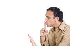 A young man with finger on lips Royalty Free Stock Image