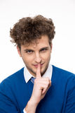 Young man with finger over lips. Handsome young man with finger over lips Royalty Free Stock Photography