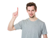 Young man with finger point upwards Stock Image