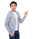 Young man with finger pointing up Stock Photography