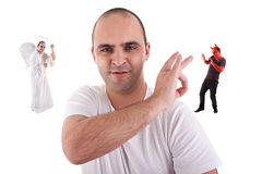 Young man with a finger removing the devin Royalty Free Stock Photo