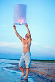 A young man with a fire lantern Royalty Free Stock Photos