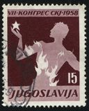 Young man on fire. RUSSIA KALININGRAD, 12 NOVEMBER 2016: stamp printed by Yugoslavia, shows a young man on fire, circa 1958 Royalty Free Stock Image