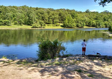 Young Man Fishing Barbours Pond, Garret Mountain Reservation, USA Stock Images