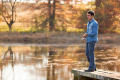 Young man fishing Stock Photography