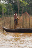 Young man with fishing net Stock Photo