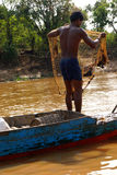 Young man with fishing net Royalty Free Stock Image