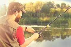 Free Young Man Fishing On A River Royalty Free Stock Photography - 125423537